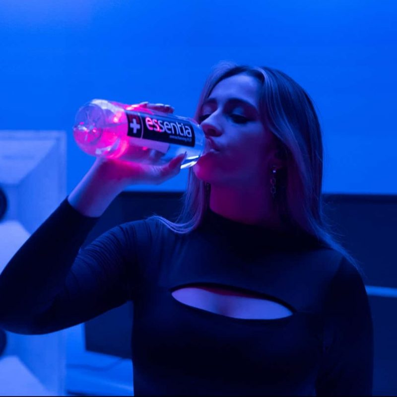Tate McRae drinking Essentia Water